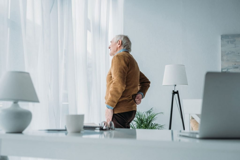 senior-man-working-in-office-suffering-from-back-pain_1200px