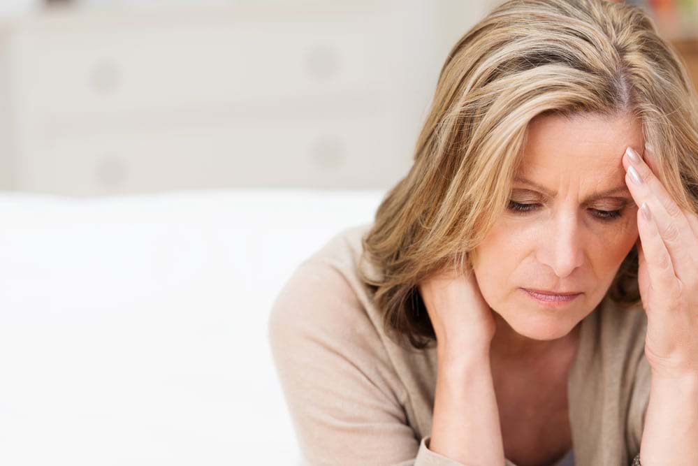 Woman suffering from stress grimacing in pain