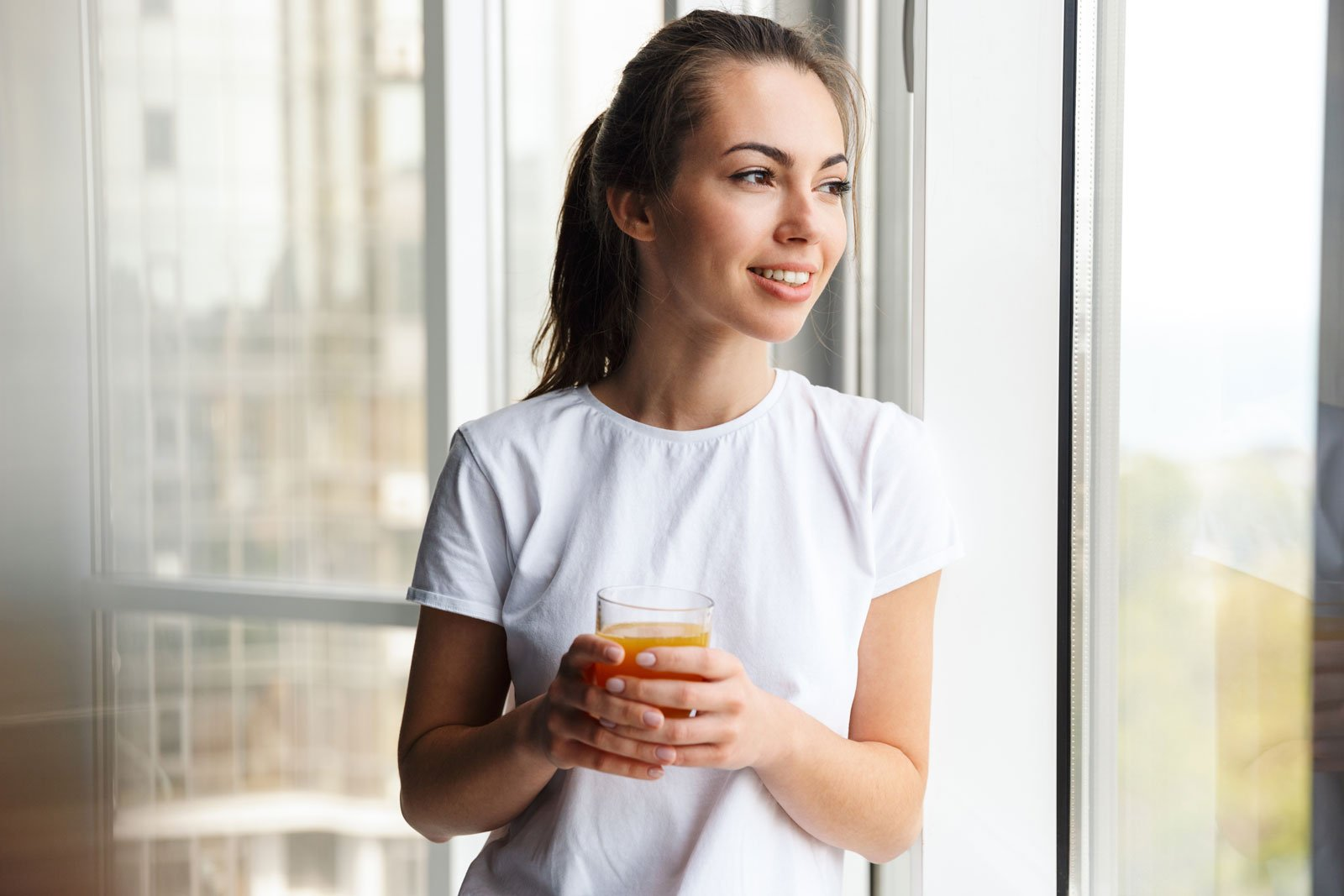 image-of-pleased-woman-smiling-and-drinking-fresh--QE7QQSL