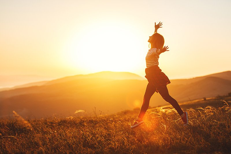 woman-sunset-jump